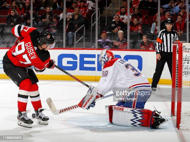 Charlie Lindgren of the Montreal Canadiens stops a shot on goal by Nikita Gusev of the New Jersey Devils during the shootout on February 4 2020 in...