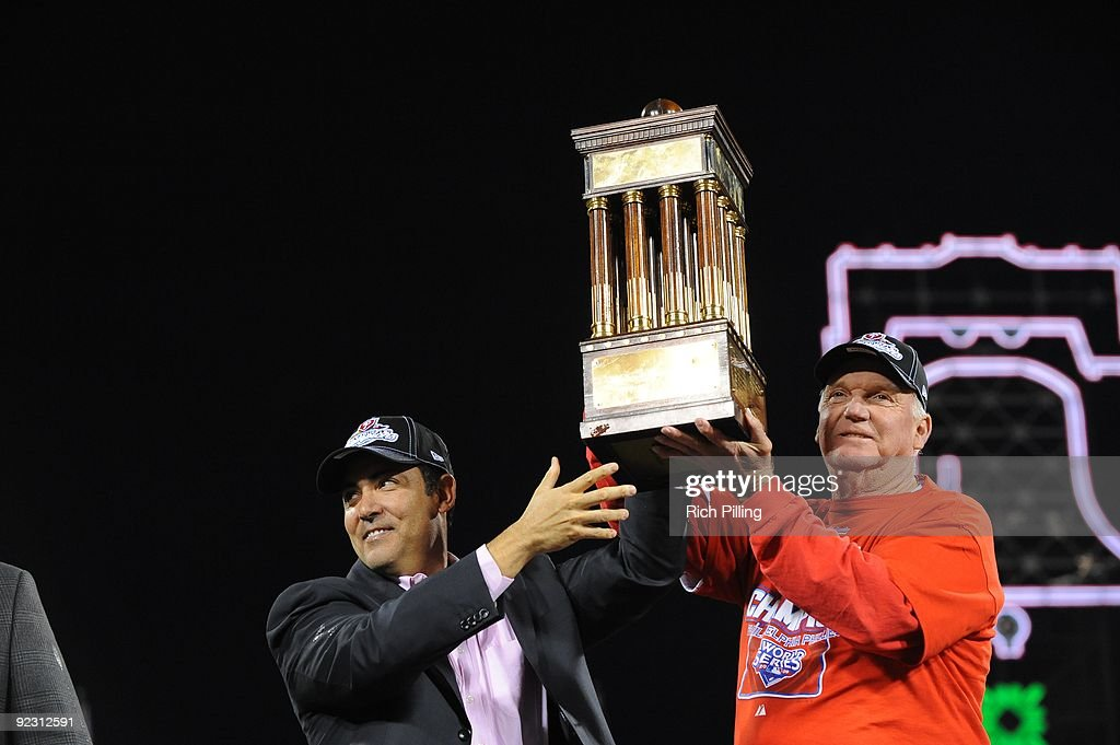 Charlie Manuel, manager of the Philadelphia Phillies, right and Ruben Amaro, General Manager hold up the National League Championship Trophy during Game Five of the National League Championship Series (NLCS) against the Los Angeles Dodgers at Citizens Bank Park in Philadelphia, Pennsylvania on October 21, 2009. The Phillies defeated the Dodgers 10-4.