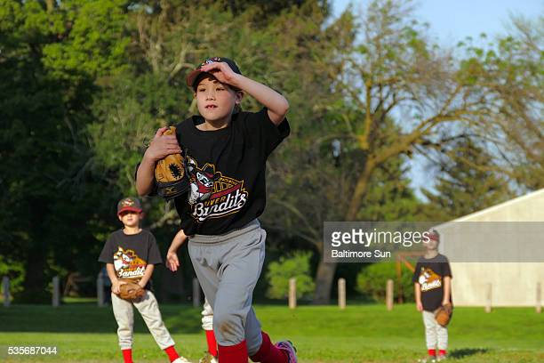 Charlie Martin runs off the field after her team recorded the final out of the inning during youth league baseball at Dumbarton Middle School's...