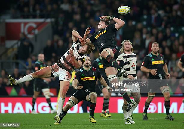 Charlie Matthews of Harlequins jumps for a high ball with Billy Twelvetrees of Gloucester during the Aviva Premiership 'Big Game 8' match between...