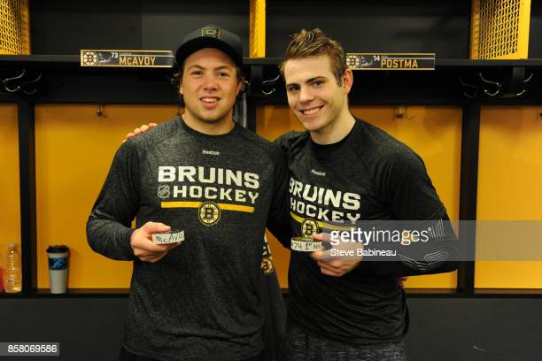 Charlie McAvoy and Jake DeBrusk of the Boston Bruins celebrate their first NHL goals against the Nashville Predators at the TD Garden on October 5...
