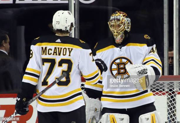 Charlie McAvoy and Tuukka Rask of the Boston Bruins celebrate a 51 victory over the New York Islanders at the Barclays Center on January 2 2018 in...