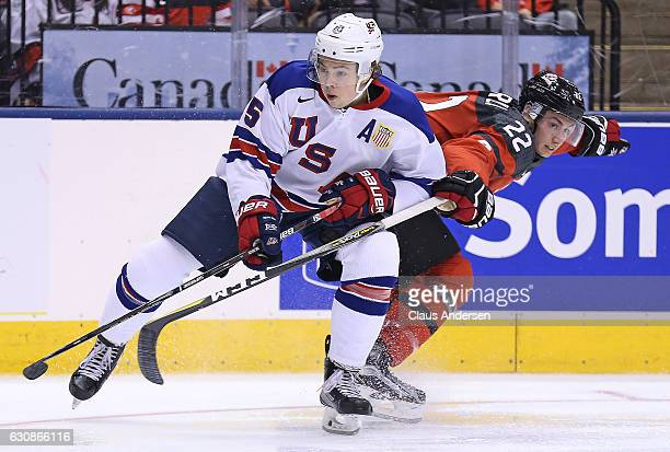 Charlie McAvoy of Team USA skates against Anthony Cirelli of Team Canada during a preliminary round game in the 2017 IIHF World Junior Hockey...