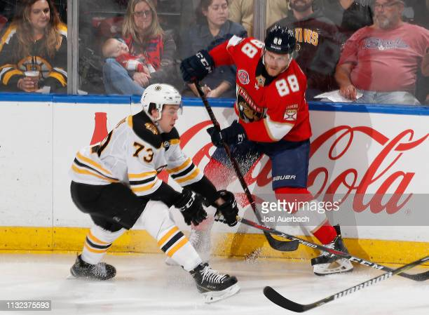 Charlie McAvoy of the Boston Bruins and Jamie McGinn of the Florida Panthers come together during third period action at the BBT Center on March 23...