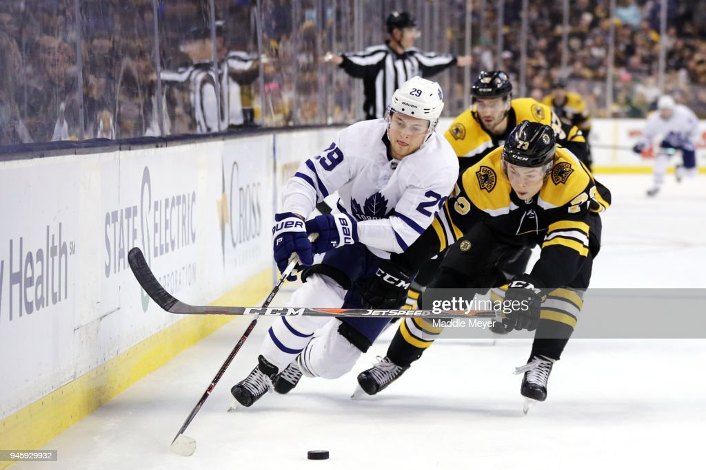 Charlie McAvoy #73 of the Boston Bruins and William Nylander #29 of the Toronto Maple Leafs battle for control of the puck during the second period of Game One of the Eastern Conference First Round during the 2018 NHL Stanley Cup Playoffs at TD Garden on April 12, 2018 in Boston, Massachusetts.