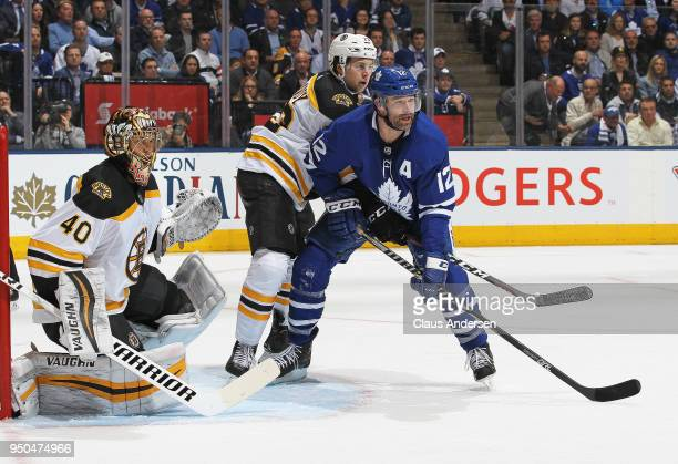 Charlie McAvoy of the Boston Bruins battles against Patrick Marleau of the Toronto Maple Leafs in Game Six of the Eastern Conference First Round in...