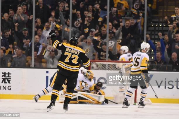 Charlie McAvoy of the Boston Bruins celebrates a goal against the Pittsburgh Penguins at the TD Garden on March 1 2018 in Boston Massachusetts