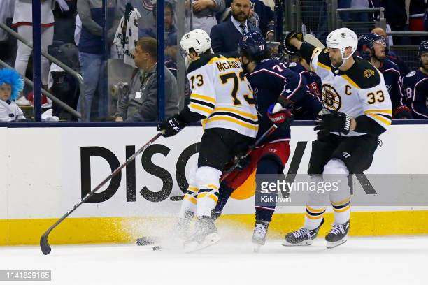 Charlie McAvoy of the Boston Bruins checks Josh Anderson of the Columbus Blue Jackets in the head during the second period in Game Six of the Eastern...