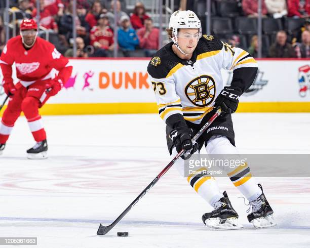 Charlie McAvoy of the Boston Bruins controls the puck against the Detroit Red Wings during an NHL game at Little Caesars Arena on February 9, 2020 in...