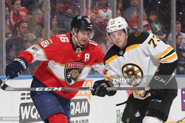 Charlie McAvoy of the Boston Bruins defends against Aleksander Barkov of the Florida Panthers at the BBT Center on April 5 2018 in Sunrise Florida...