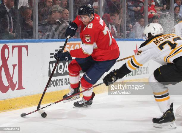Charlie McAvoy of the Boston Bruins defends against Maxim Mamin of the Florida Panthers as he skates behind the net with the puck at the BBT Center...
