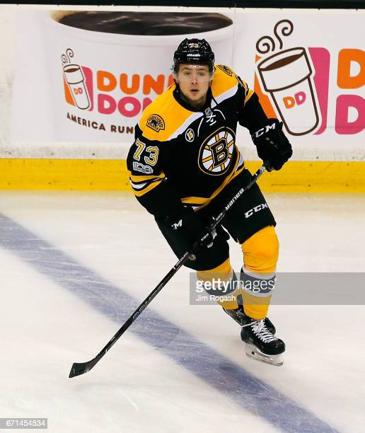 Charlie McAvoy of the Boston Bruins defends against the Ottawa Senators in the first period against the Boston Bruins in Game Three of the Eastern...