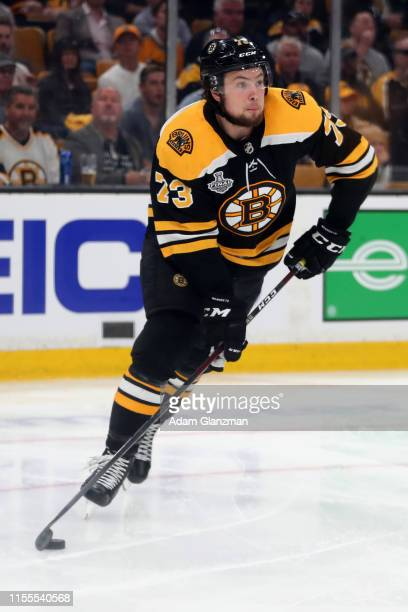 Charlie McAvoy of the Boston Bruins handles the puck against the St. Louis Blues during the second period in Game Seven of the 2019 NHL Stanley Cup...
