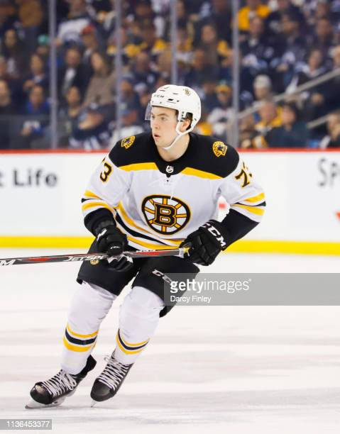 Charlie McAvoy of the Boston Bruins keeps an eye on the play during first period action against the Winnipeg Jets at the Bell MTS Place on March 14...