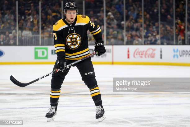 Charlie McAvoy of the Boston Bruins looks on during the first period of the game against the Calgary Flames at TD Garden on February 25, 2020 in...