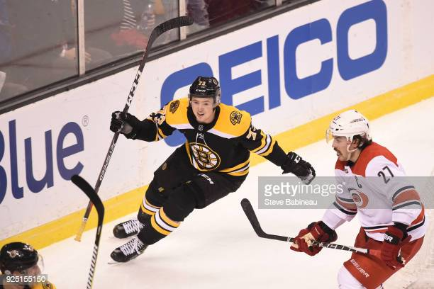Charlie McAvoy of the Boston Bruins scores in overtime against the Carolina Hurricanes at the TD Garden on February 27 2018 in Boston Massachusetts