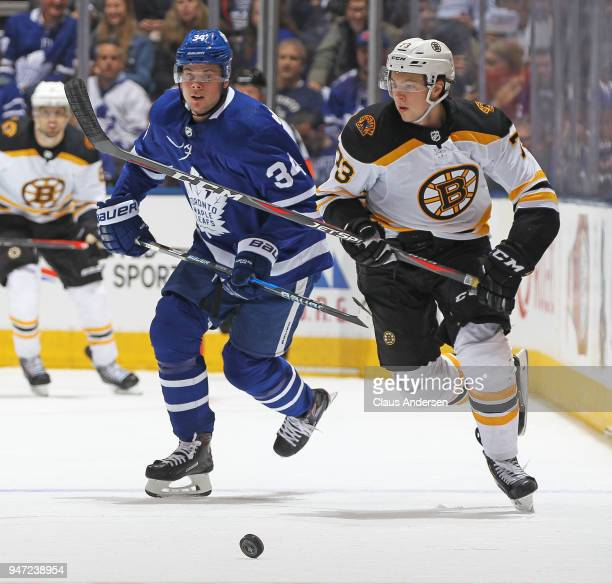 Charlie McAvoy of the Boston Bruins skates against Auston Matthews of the Toronto Maple Leafs in Game Three of the Eastern Conference First Round...