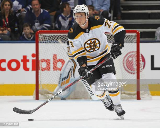 Charlie McAvoy of the Boston Bruins skates with the puck against the Toronto Maple Leafs in Game Three of the Eastern Conference First Round during...