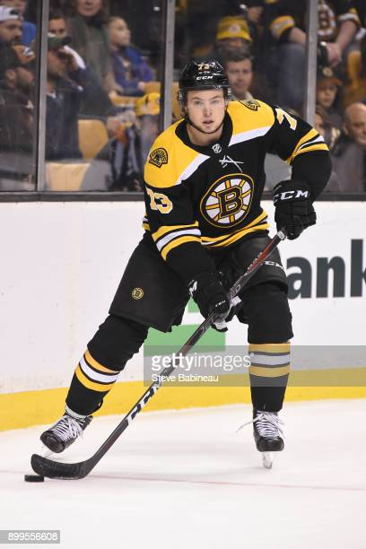 Charlie McAvoy of the Boston Bruins skates with the puck against the Ottawa Senators at the TD Garden on December 27 2017 in Boston Massachusetts