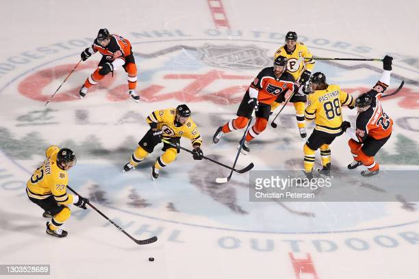 Charlie McAvoy of the Boston Bruins skates with the puck during the 'NHL Outdoors At Lake Tahoe' against the Philadelphia Flyers at the Edgewood...
