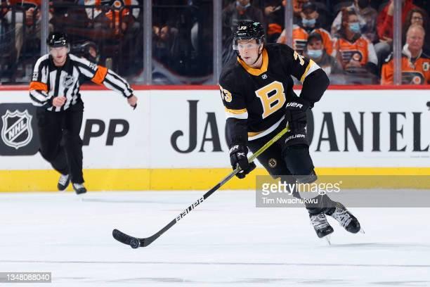 Charlie McAvoy of the Boston Bruins skates withthe puck against the Philadelphia Flyers at Wells Fargo Center on October 20, 2021 in Philadelphia,...