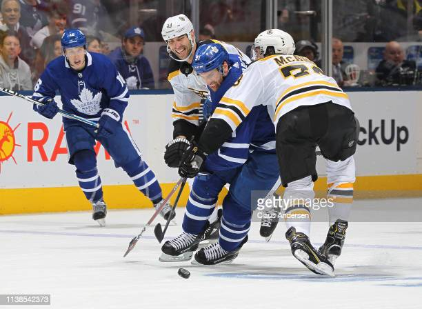 Charlie McAvoy of the Boston Bruins ties up John Tavares of the Toronto Maple Leafs in Game Six of the Eastern Conference First Round during the 2019...