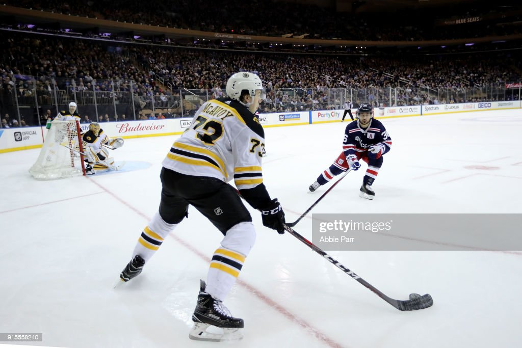 Charlie McAvoy #73 of the Boston Bruins works against Mats Zuccarello #36 of the New York Rangers in the third period during their game at Madison Square Garden on February 7, 2018 in New York City.