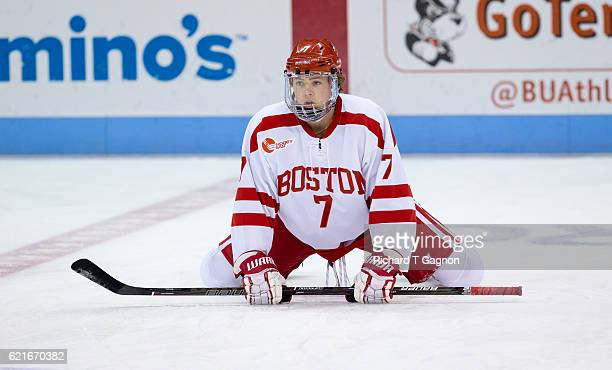 Charlie McAvoy of the Boston University Terriers stretches in warmups prior to a game against against the Northeastern Huskies before NCAA hockey at...