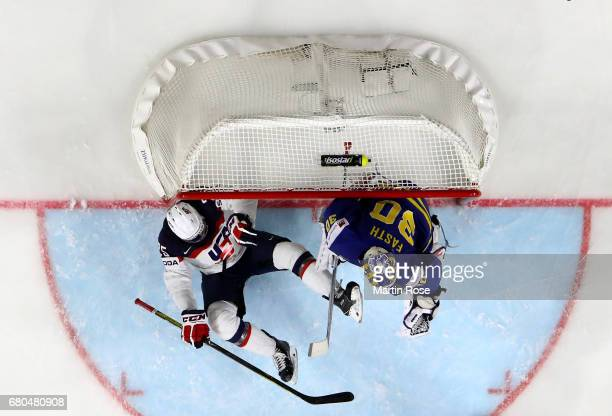 Charlie McAvoy of USA slides into the net during the 2017 IIHF Ice Hockey World Championship game between USA and Sweden at Lanxess Arena on May 8,...