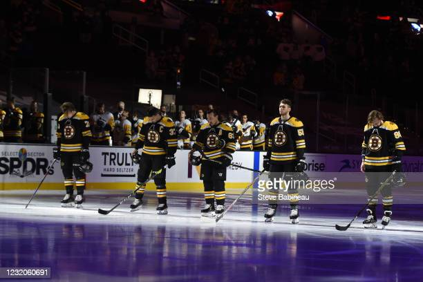 Charlie McAvoy, Patrice Bergeron, Brad Marchand, Jeremy Lauzon and David Pastrnak of the Boston Bruins stand for the national anthem before the game...