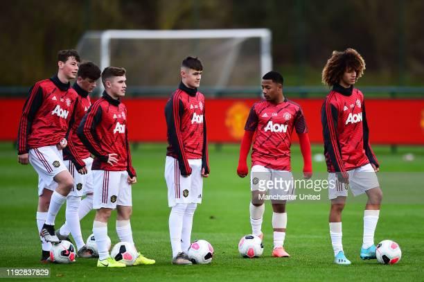 Charlie McCann, Mark Helm, Shola Shoretire and Hannibal Mejbri of Manchester United U18s warm up ahead of the U18 Premier League match between...