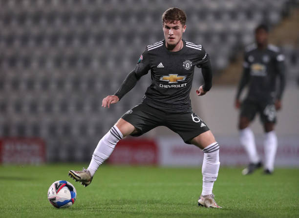 Charlie McCann of Manchester United U21 controls the ball during the EFL Trophy match between Morecambe and Manchester United U21 at Mazuma Stadium...