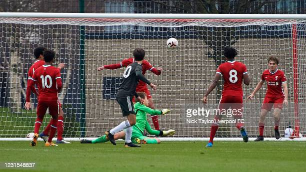 Charlie McNeill of Manchester United scores during the U18 Premier League game between Liverpool and Manchester United at AXA Training Centre on...