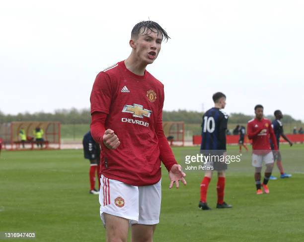 Charlie McNeill of Manchester United U18s celebrates scoring their fourth goal during the U18 Premier League match between Manchester United U18s and...