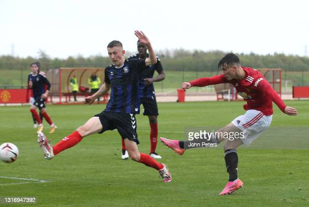 Charlie McNeill of Manchester United U18s scores their fourth goal during the U18 Premier League match between Manchester United U18s and...