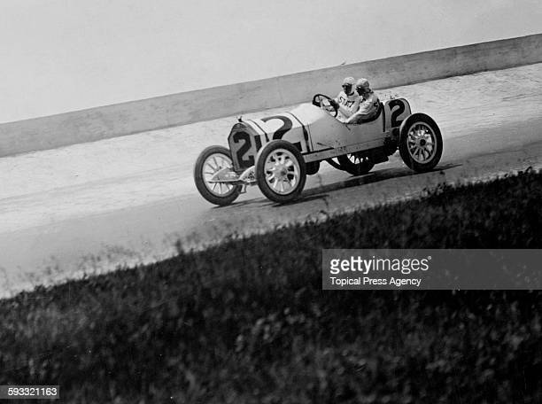 Charlie Merz of the United States with his riding mechanic Harry Martin aboard the Stutz Motor Company Stutz Bearcat racer during the third running...
