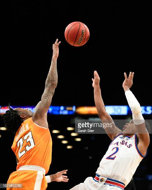 Charlie Moore of the Kansas Jayhawks shoots against Jordan Bowden of the Tennessee Volunteers during the first half of the game at the NIT Season...