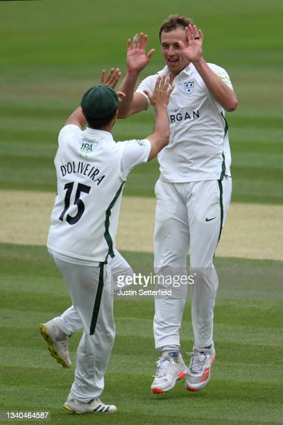 Charlie Morris of Worcestershire celebrates taking the wicket of Luke Hollman of Middlesex with Brett D'Oliveira of Worcestershire during the LV=...