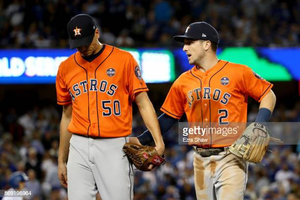 Charlie Morton and Alex Bregman of the Houston Astros walk to the dugout after the sixth inning against the Los Angeles Dodgers in game seven of the...