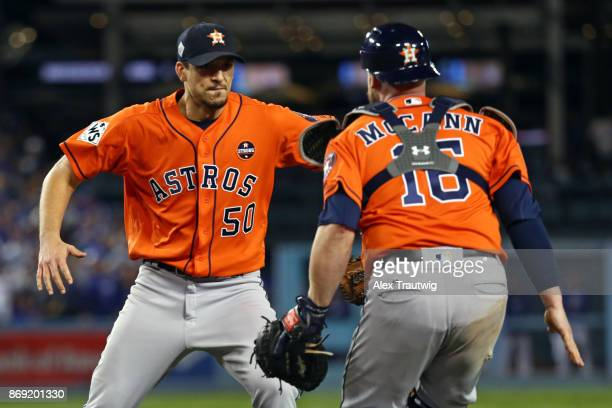 Charlie Morton and Brian McCann of the Houston Astros celebrate after the Astros defeated the Los Angeles Dodgers in Game 7 of the 2017 World Series...