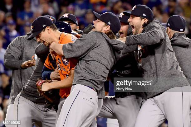 Charlie Morton of the Houston Astros celebrates with teammates after defeating the Los Angeles Dodgers in game seven with a score of 5 to 1 to win...