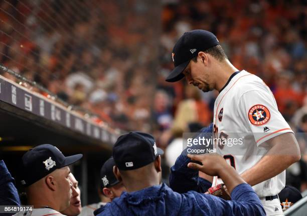 Charlie Morton of the Houston Astros is congratulated by teammates as he returns to the dugout at the end of the top of the fifth inning of Game 7 of...