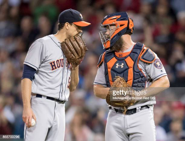 Charlie Morton of the Houston Astros talks to catcher Evan Gattis pitching against the Boston Red Sox in the fourth inning at Fenway Park on...