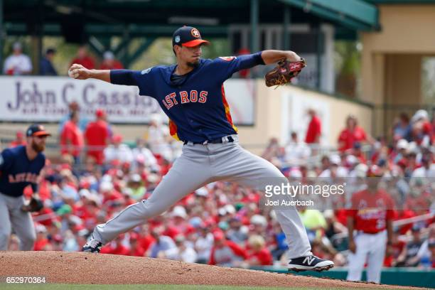 Charlie Morton of the Houston Astros throws the ball against the St Louis Cardinals in the first inning during a spring training game at Roger Dean...