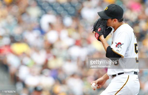 Charlie Morton of the Pittsburgh Pirates covers his face with his glove while walking to the mound against the St Louis Cardinals during the game on...