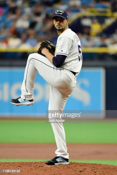 Charlie Morton of the Tampa Bay Rays prepares to deliver a pitch to the Los Angeles Angels of Anaheim in the second inning of a baseball game at...