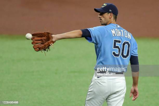 Charlie Morton of the Tampa Bay Rays receives a new ball after giving up a home run to the Boston Red Sox in the first inning at Tropicana Field on...