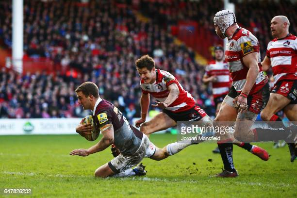 Charlie Mulchrone of Harlequins touches down a try during the Aviva Premiership match between Gloucester Rugby and Harlequins at Kingsholm Stadium on...