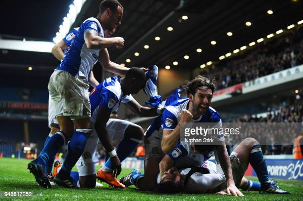 Charlie Mulgrew of Blackburn Rovers celebrates with Bradley Dack after he scores the third goal during the Sky Bet League One match between Blackburn...