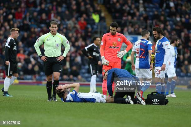 Charlie Mulgrew of Blackburn Rovers recieves treatment for an injury during the Sky Bet League One match between Blackburn Rovers and Northampton...